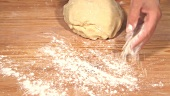 The work surface being dusted with flour for the dough to be kneaded