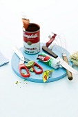 Convenience products: green Erbswurst (dried, ground peas compressed into a sausage shape) and tinned tomato soup