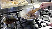 Bolognese sauce being made: minced meat and vegetable mixture simmering in a pan