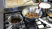 Bolognese sauce being made: red wine being added to the minced meat and vegetable mixture