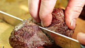 Fried point steak being sliced