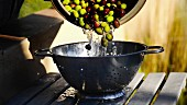 Washed olives being transferred to a colander