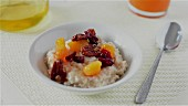 Porridge decorated with dried fruit, nuts and honey