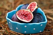Fresh figs in a heart-shaped dish