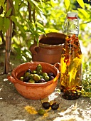 Marinated olives and a bottle of olive oil