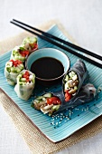 Cucumber rolls made with rice paper or nori, with a soy dip