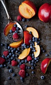 Raspberries, blueberries and sliced red plums