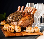 Dry Aged Frenched Prime Rib Roast with Whole Bulbs of Garlic