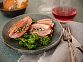 Sliced Herb Stuffed Duck Served with Broccoli Rabe