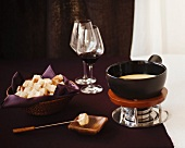 Cheese Fondue with Bread and Red Wine