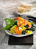 Fried prawns on a bed spinach with saffron and ramson sauce