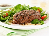 Lamb steak with mint and salad