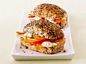 Poppyseed rolls filled with hummus and pepper