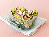 Mushrooms salad with avocado and sausage in a lunchbox