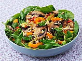 Mushroom salad with peppers and sesame seeds