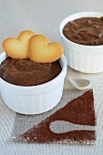 Chocolate pudding with heart-shaped biscuits
