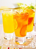 Three tangerine and grapefruit drinks