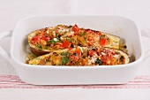 Gratinated aubergine with a vegetable rice filling