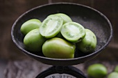 Green tomatoes in an antique scales