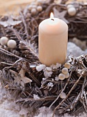 Advent wreath with one candle