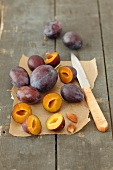 Fresh plums, whole and sliced