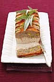 Chicken terrine with chicken liver wrapped in bacon