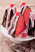 Slices of cherry cake with chocolate glaze