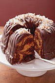 Marble cake with chocolate glaze and grated coconut