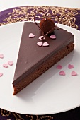 A slice of chocolate cake with a velvety truffle praline for Valentine's Day