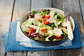 Mixed leaf salad with cherry tomatoes, cucumber and Parmesan