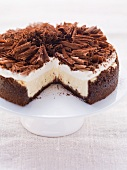 Chocolate cheesecake topped with cream and grated chocolate