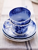 Two blue coffee cups and saucers