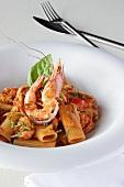 Pasta with king prawns, tomato sauce and basil