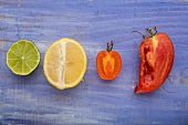 A lime, a lemon, a yellow tomato and an Andenhorn tomato