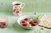 Porridge made with chia seeds and macadamia nuts with fresh strawberries