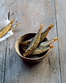 Smoked sardines in a clay dish