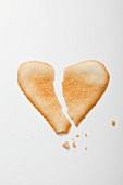 A broken heart-shaped biscuit