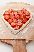 A tomato cake on a piece of baking paper
