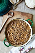 Beef stroganoff with mushrooms in a pot