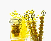 Green olives with olive oil bubbles