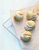 Scones on a piece of baking paper on a wire rack