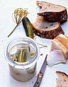 Pickled gherkins, bacon and bread