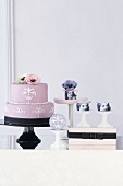 An arrangement of designer cakes and cupcakes