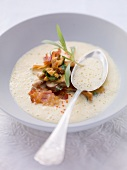 Cream of potato soup with fried mushrooms and bacon