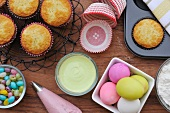 An arrangement of muffins, Easter eggs and cupcake ingredients