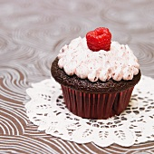 Chocolate Cupcake with Raspberry Frosting with a Fresh Raspberry Garnish