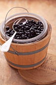 A bucket of blueberries in a small wooden barrel