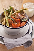 Oven-roasted vegetables in an enamel bowl
