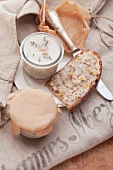 Homemade lard in jars and on slices of bread