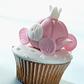 A cupcake decorated with a fairytale decoration